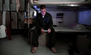 An inmate in New Hampshire state prison for men reads a tablet