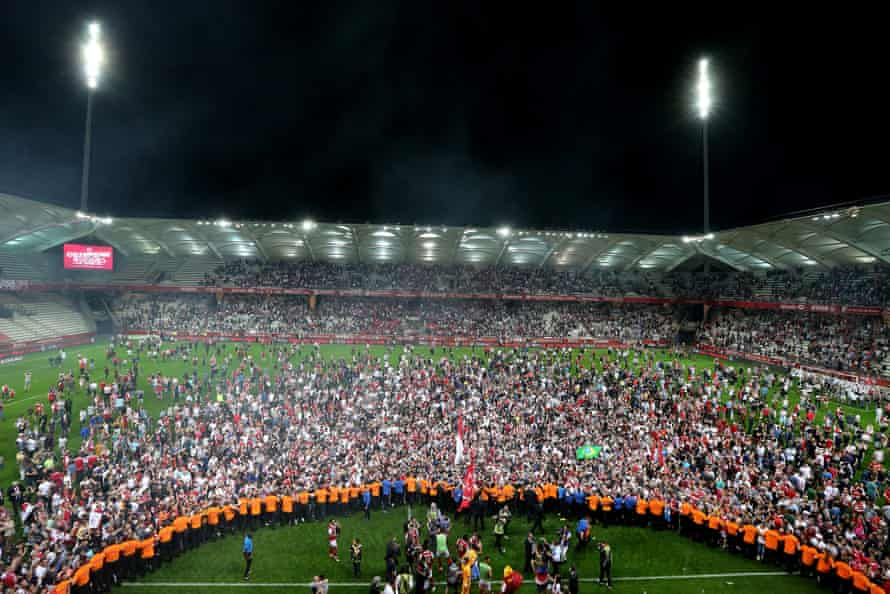 Reims' supporters celebrate after Stade de Reims won promotion to the Ligue 1 on 20 April 2018 at the Auguste Delaune Stadium.