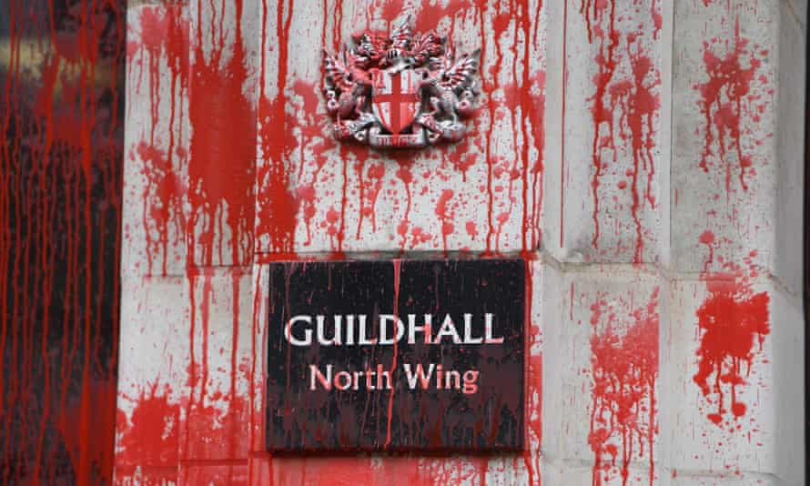 Red paint over a sign on the Guildhall sign during the Extinction Rebellion protest in London