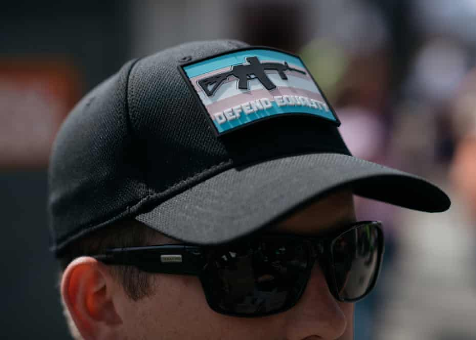 A John Brown Gun Club member wears a patch featuring the Trans Pride flag and an AR-15 while community defending Trans Pride in Seattle.