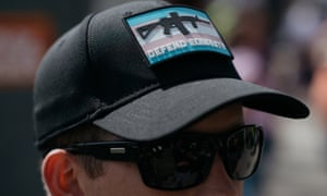 A John Brown Gun Club member wears a patch featuring the Trans Pride flag and an AR-15 at Trans Pride in Seattle last month.