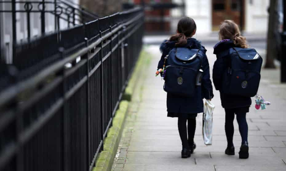 Children leaving a school in London after it was closed by the coronavirus outbreak, March 2020