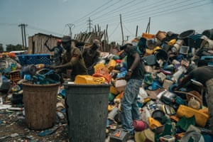 Workers at Accra waste management plant segregating plastic waste