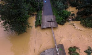A bridge damaged by floods is pictured at Chai Buri District, Surat Thani province, southern Thailand, January 9, 2016. Picture taken January 9, 2016. Dailynews/ via REUTERS ATTENTION EDITORS - THIS IMAGE WAS PROVIDED BY A THIRD PARTY. EDITORIAL USE ONLY. NO RESALES. NO ARCHIVE. THAILAND OUT.