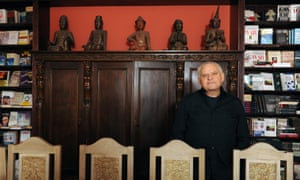 Luttwak at home in Maryland in front of some of the books he has written and translated.