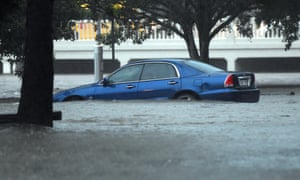 A car is submerged in flood water in Stones Corner in Brisbane on Friday.