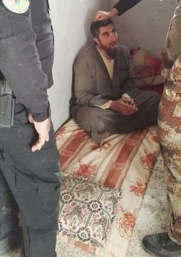 Ali Amin Abdullah being interrogated by an Iraqi army officer in Gogjali, Mosul, in November.