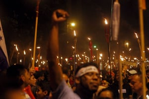 Honduran Demonstrators march to demand the resignation of President Juan Orlando Hernandez.