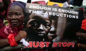 A woman protests against the abduction by Boko Haram of girls from Chibok in May 2014.