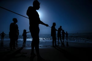 Fuengirola, Spain Men participate in the banned traditional fishing method of tirada del copo during an event at Los Boliches beach. The technique was made illegal in the 1960s in an attempt to secure fishing resources