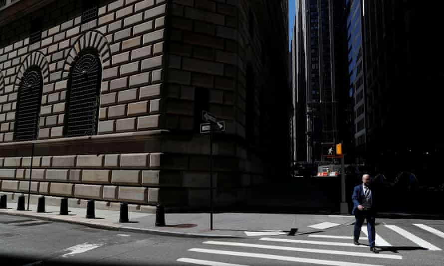A man walks past the Federal Reserve building in New York. A boom in commodity prices is in full swing.