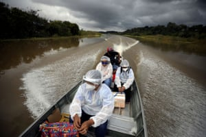 Municipal health workers travel on a boat along the Solimoes river to administer the AstraZeneca/Oxford vaccine to the residents of Manacapuru in the state of Amazonas.