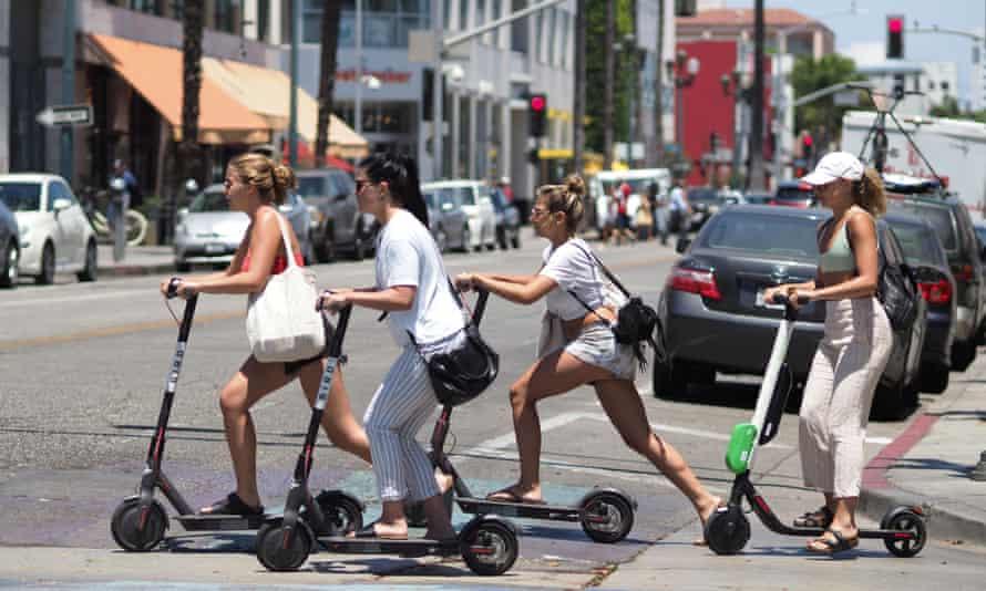 Women ride shared e-scooters in Santa Monica, California.