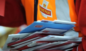 A worker sorts letters at the Royal Mail distribution centre in Glasgow