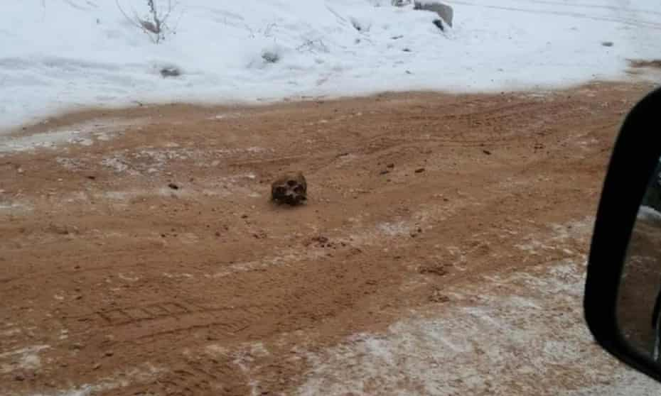 The remains were buried in sand that was spread over a local road to improve traction on black ice