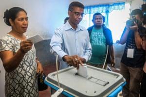 Democratic party candidate Antonio da Conseicao casts his vote.