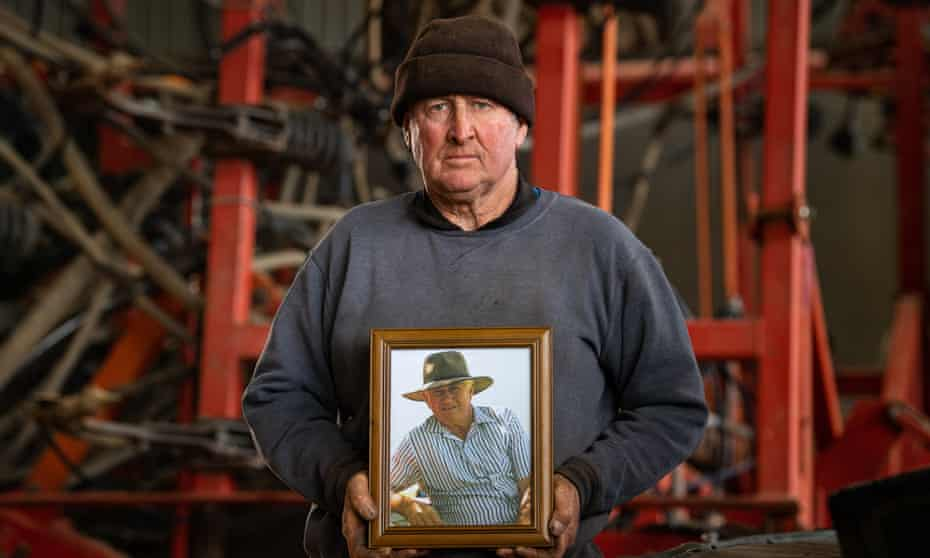 Grain grower Wayne Prosser holds a photo of his late father Ronald 'Rusty' Prosser