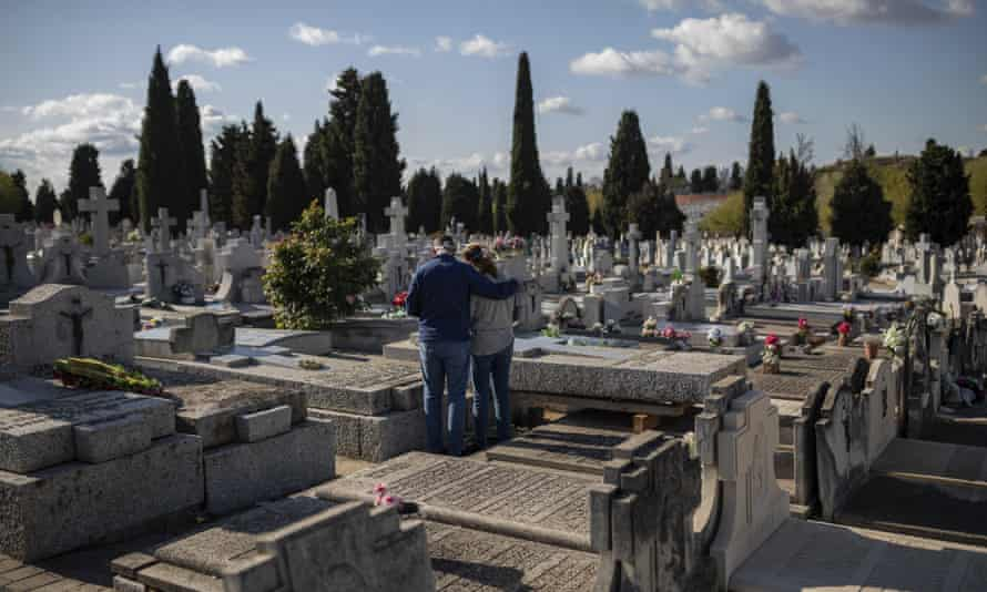 A burial at a Madrid cemetery last week: Spain's death toll is now second only to Italy's.