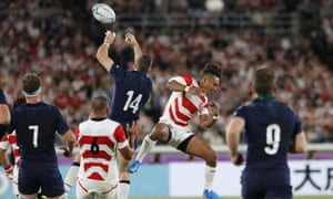 Scotland's Tommy Seymour, top left, and Japan's Kotaro Matsushima vie for the ball during their crucial Rugby World Cup game.