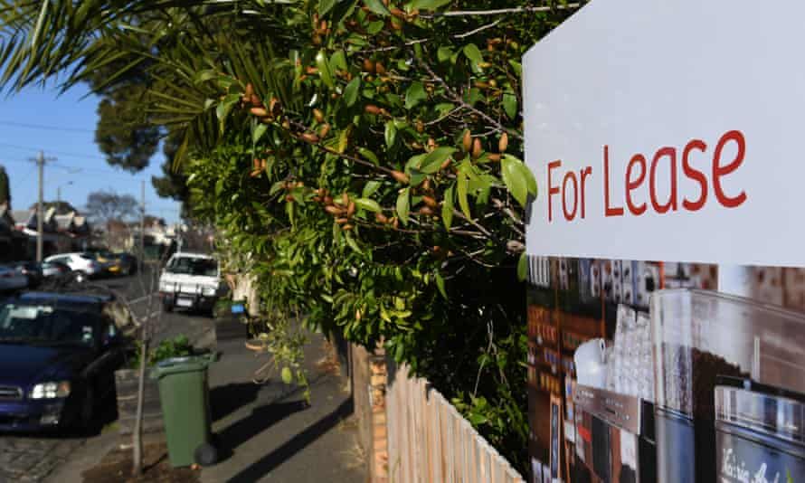 A 'For Lease' sign outside a house