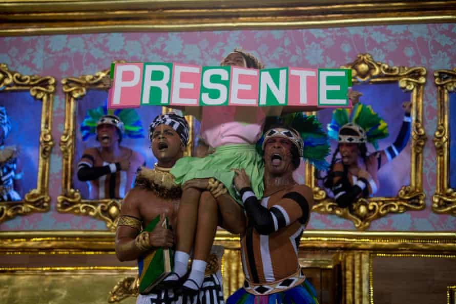 A girl represents slain Rio de Janiero's councilor and activist Marielle Franco as she performs with the Mangueira samba school during the second night of Rio's Carnival parade at the Sambadrome.