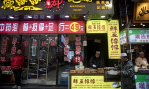 A foot massage shop and a halal food stall in Xiyangshi Street.