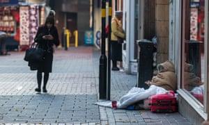 A rough sleeper begging in Birmingham