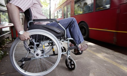 Disabled man in wheelchair at bus stop