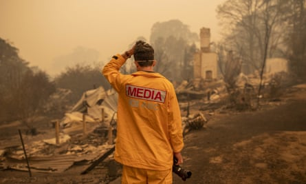 ABC photographer Matt Roberts reacts to seeing his sister's house destroyed by a bushfire in Quaama, NSW, on 1 January.
