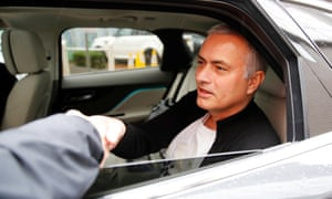 José Mourinho leaves the Lowry Hotel, presumably with his big plate in tow.