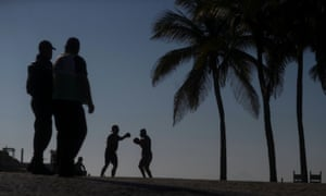 People exercise on the first day of beaches reopening in Rio de Janeiro, Brazil, on 2 June.