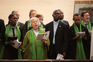 People sing at the memorial service