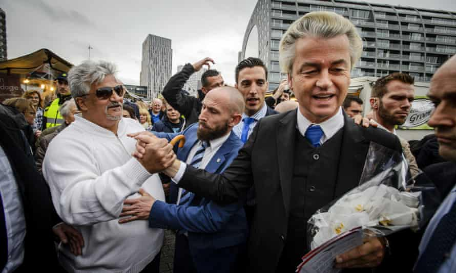 Far-right leader Geert Wilders is greeted in Rotterdam during a protest against the provision of emergency accommodation for refugees.