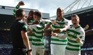 Celtic players celebrates after scoring their team's second goal.