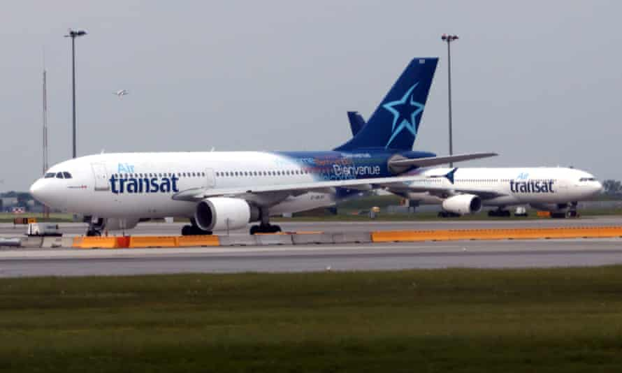 Air Transat jets prepare to take off at at Montréal Pierre Elliott Trudeau international airport in Canada. Air Canada has reached a deal to buy Transat for C$520m.