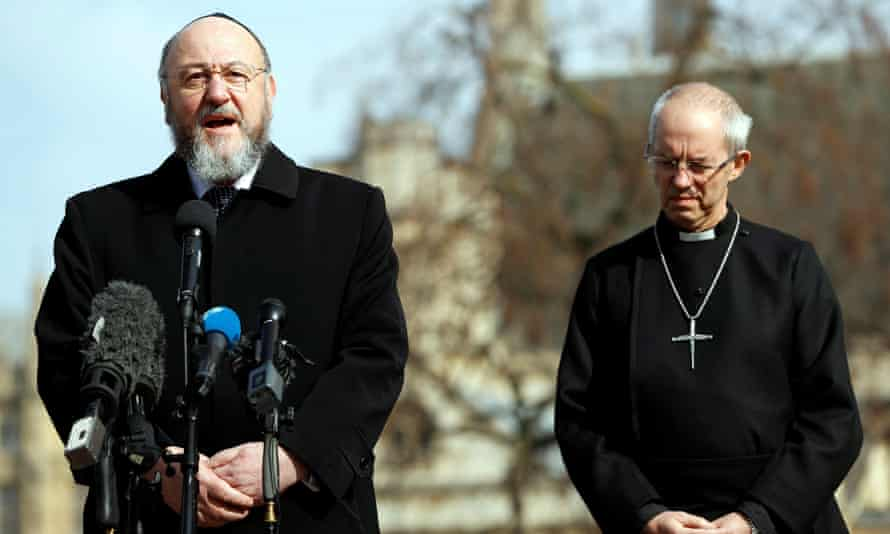 The archbishop of Canterbury, Justin Welby, right, listens to the chief rabbi, Ephraim Mirvis, speak in 2017.