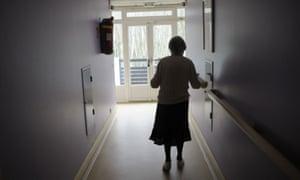 An elderly woman in a corridor