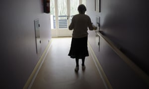 This file photo taken on 18 March 2011 shows a woman, suffering from Alzheimer's disease, walking in a corridor in a retirement house in Angervilliers, eastern France.