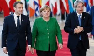 Merkel, Macron (left) and Italian PM Paolo Gentiloni.
