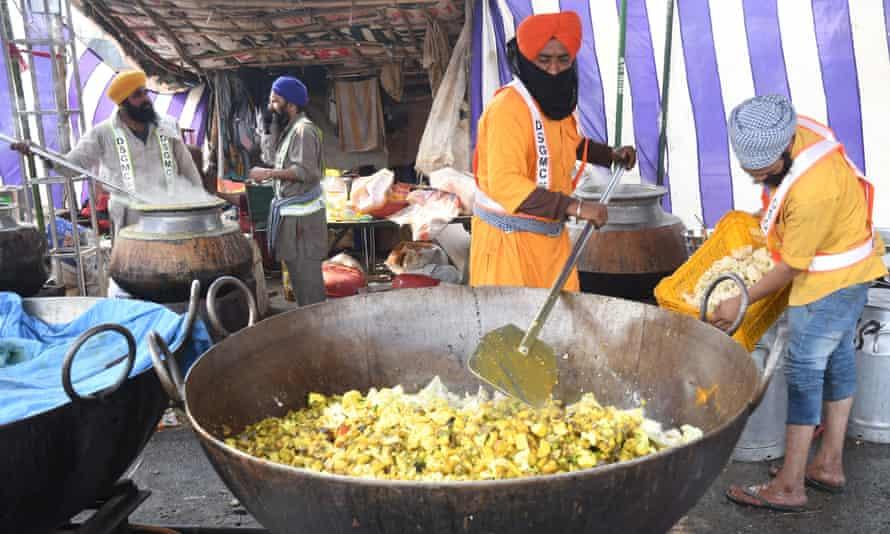 A make-shift community kitchen prepares food for protesting farmers at the Delhi-Haryana border in Singhu