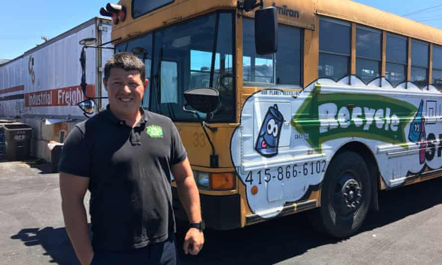 Ors Csaszar, of One Planet Recycling, poses with the bus he uses to ferry recyclers from San Francisco's Chinatown.