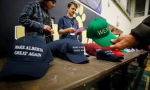 A man buys a hat to raise funds at a rally for Wexit Alberta, a separatist group seeking federal political party status, in Calgary, Alberta, Canada, earlier this month.
