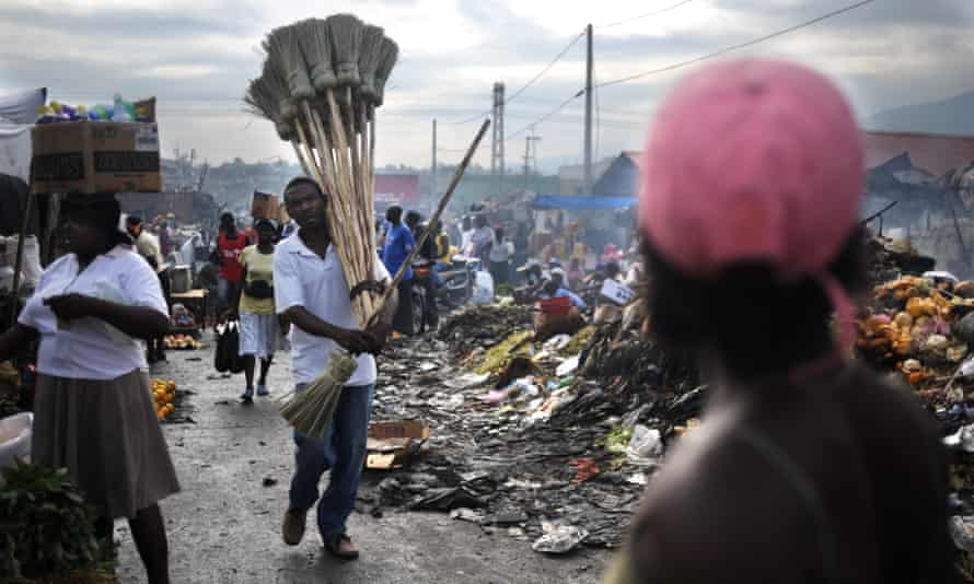A man sells brooms at a market in Port-au-Prince.