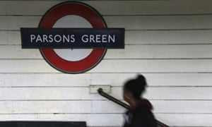 A passenger walks onto the platform at Parsons Green station after it was reopened following the terrorist attack