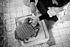 A boy is washed at the special education centre in Aousserd camp