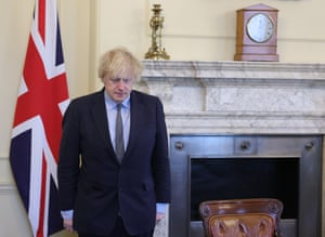 Prime Minister Boris Johnson inside the Cabinet Room of No10 Downing Street observing a minute's silence