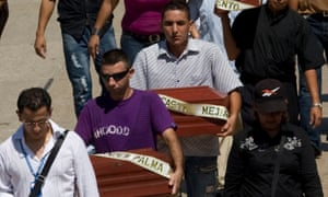 Relatives carry coffins with the remains of children during a mass funeral in Barranquilla in September 2010. Authorities turned over the corpses of six victims of the army's 'false positives' scandal.