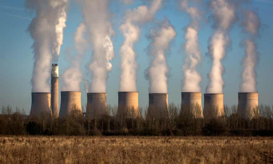 Water vapour rises from the cooling towers of Ratcliffe-on-Soar power station
