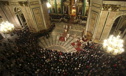 A religious service commemorating victims of the plane crash in Egypt at St Isaac's Cathedral in St Petersburg.