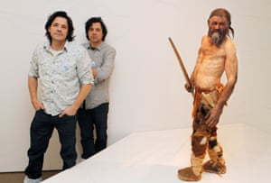 adrie and alfons kennis standing by their model of otzi the iceman